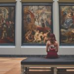 Woman sitting in a gallery viewing art