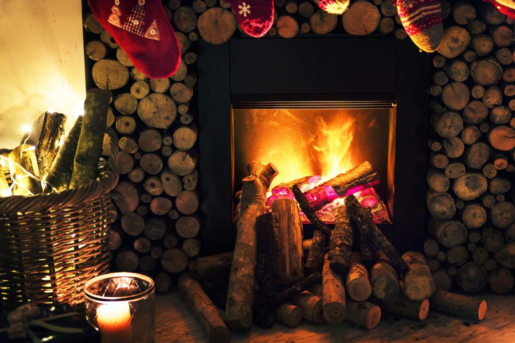 Cozy warm fireplace with stocking hung in front of it