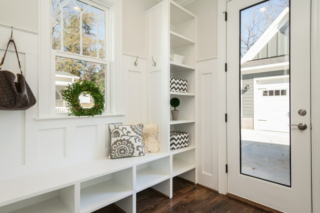 White built ins in a clean mudroom
